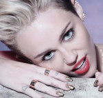 MILEY CYRUS RESPONDS TO BEING CALLED 'UGLY LESBIAN'